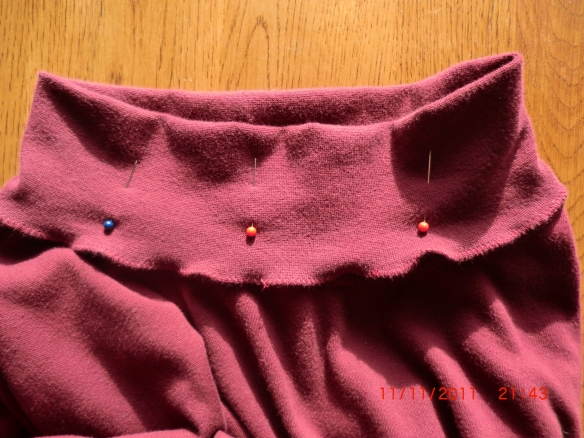Outer layer pinned down to inside of shirt.