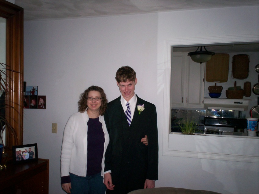 Mom and son in suit for prom.
