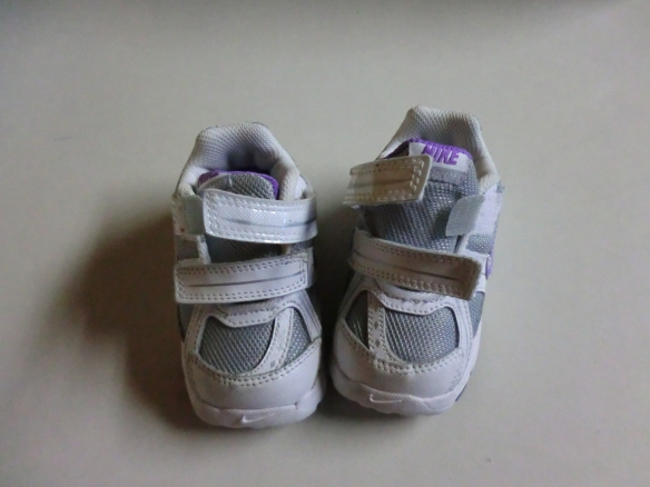 Baby shoes with Velcro extension.