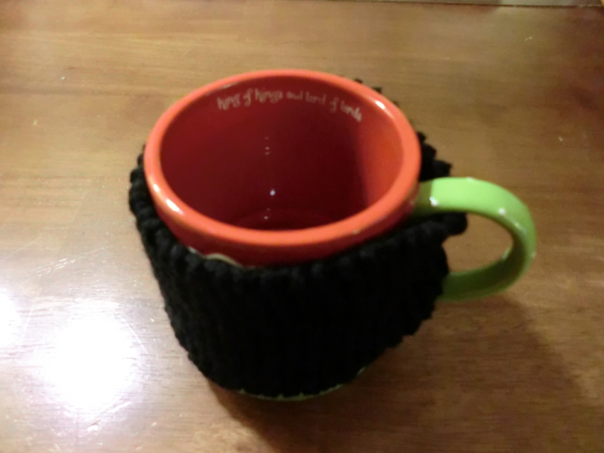 Cup with knitted Cozie around it