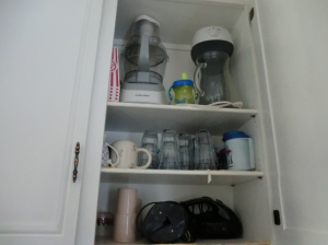 """Kitchen cabinet with copper hardware """"New Kitchen for Five Bucks"""" frugalfish.org"""