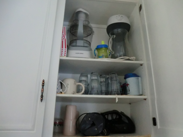 My can opener and mixer are on the bottom shelf.