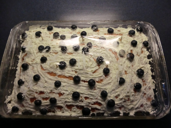 "A cake frosted with ""Ready Whip."""