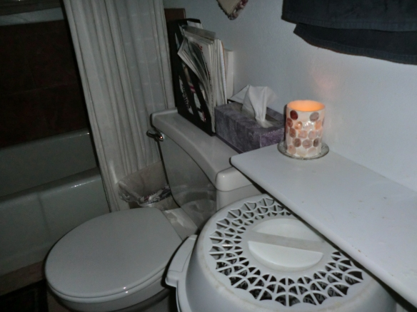 Flame-less candle lights the bathroom.