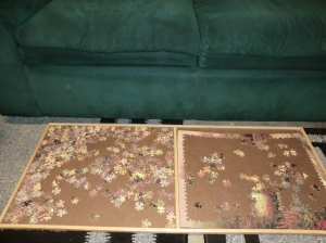 Board with partially finished puzzle on it