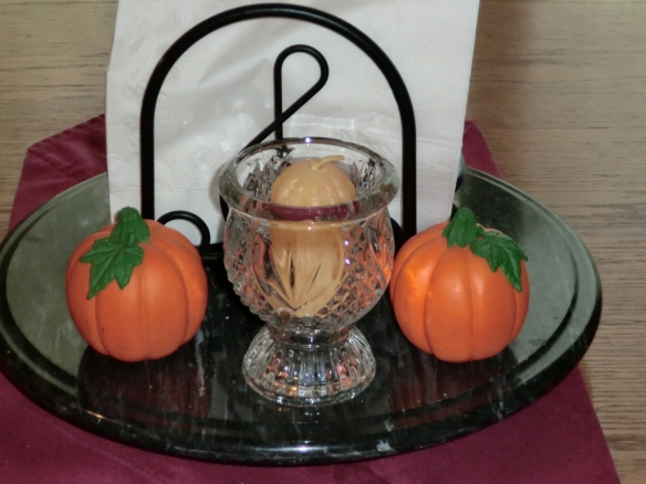 Pumpkin Salt & Pepper shakers and a yellow candle.