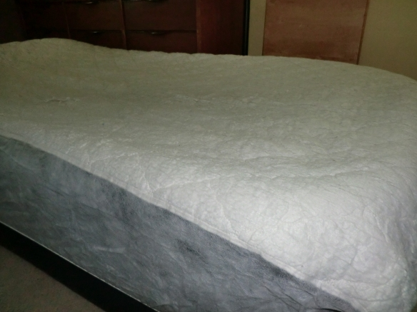 Extra long twin mattress pad designed for college dorm beds used on an air mattress.