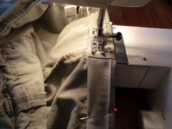 Stitching below the original line of stitching.