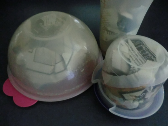 Plastic containers stuffed with newspaper and sealed for several days to absorb garlic smell.