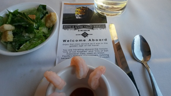 Caesar Salad, Shrimp Cocktail and Multi-Grain mini loaves.