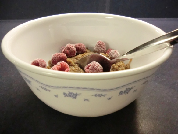 Chocolate Malto Meal cooled with frozen raspberries.