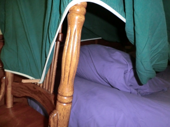 Attach a fitted sheet to a chair with clothespins to make an easy tent.