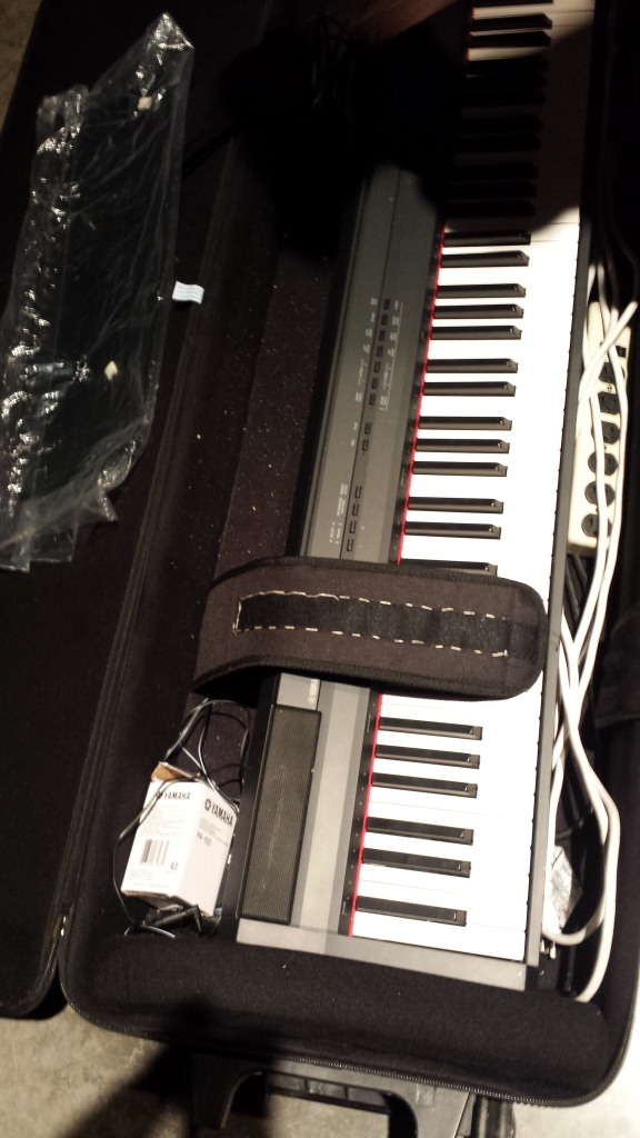 Repaired keyboard case strap with upholstery needle.