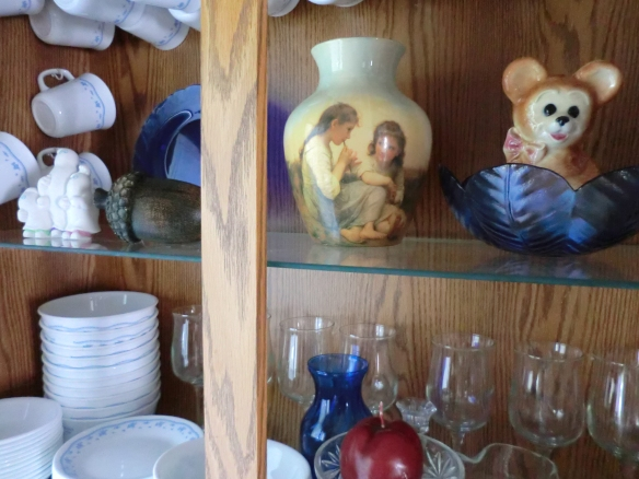 I put my sentimental decorations in the china cabinet.