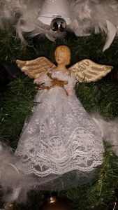 I nestled a few angel tree toppers in my tree to fill in holes.