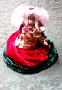 Most of my angels are clear or white. I let the angel set the color scheme for each room. This angel is sitting on top of a rolled up Christmas Tree Skirt, with a cardboard tube, and a dowel inside to support her.