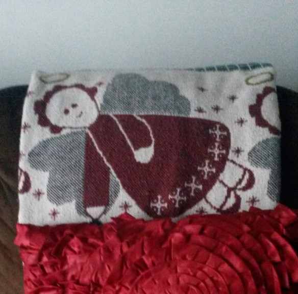 I folded my Christmas throw to place the angel in the center of it.