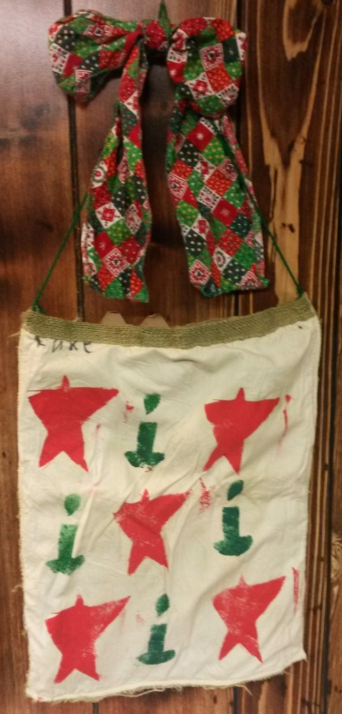 Luke made this stamped burlap bag in preschool and wore the Christmas fabric scarf in one of the Winter Programs.