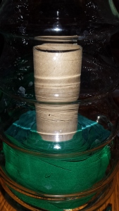 I rolled green ribbon around and empty cardboard tube to make a green tree inside of a glass tree candy jar.