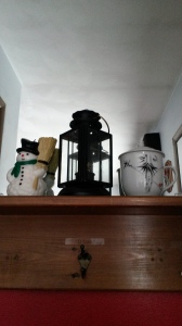 I wanted this lantern behind my front door and chose two other items with a touch of black in them. The china cup was brought back from China when my friends picked up their new daughter, Grace.
