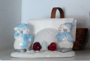 I added a few glass heart-shaped pieces to my snowmen salt and pepper shakers and napkin holder igloo.