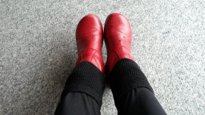 Feet wearing red boots with boot socks