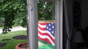 Flag through a window