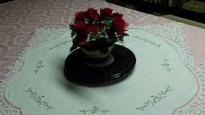 Floral arrangement on tablecloth.