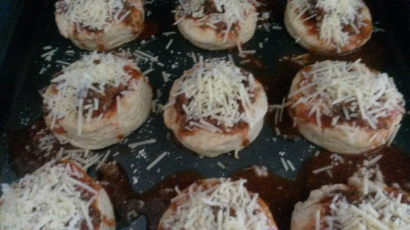 Biscuits, spaghetti sauce and cheese