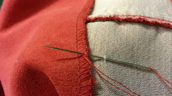 Tacking jacket lining down.