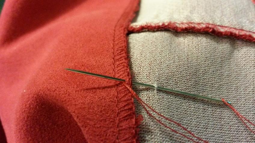 Tacking jacket lining down.