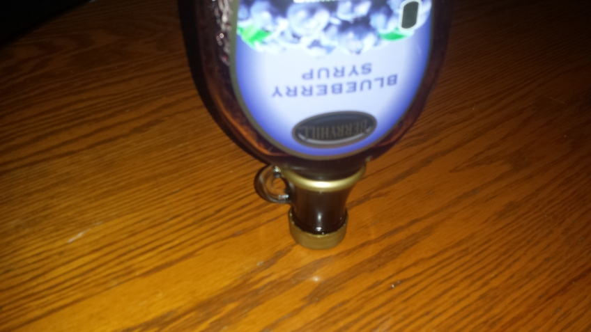 Upside down jar of blueberry syrup