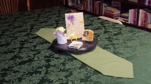Butterfly-themed centerpiece on table runner.