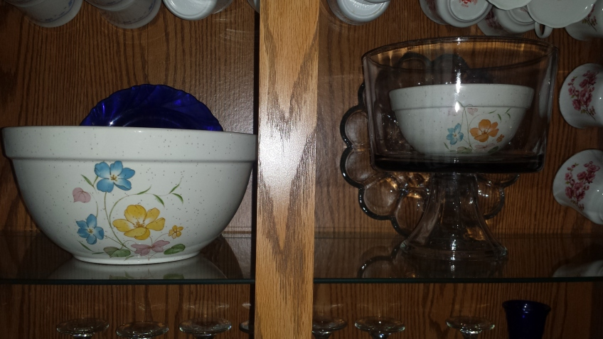 Floral Mixing bowls in china cabinet