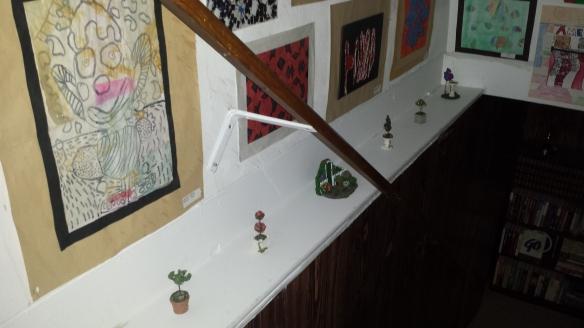 Ceramic garden figures on shelf