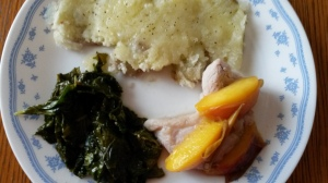 Potatoes, Pork, Peaches, and Kale on a plate.
