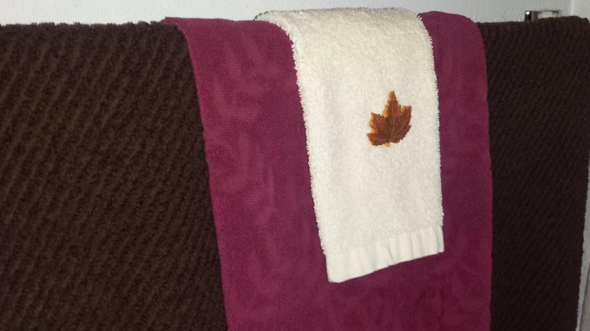 """Leaf brooch on towels, """"September Decoration Flip"""" frugalfish.org"""