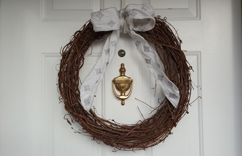 "Grapevine wreath on door ""Whiter than Snow"" frugalfish.org"