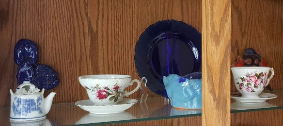 "Clay Art in China Cabinet ""Displaying Precious Artwork"" frugalfish.org"
