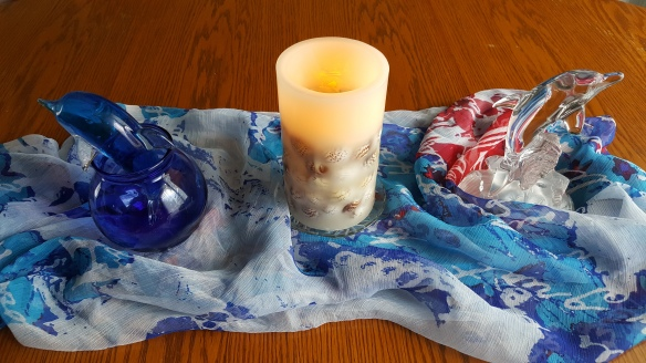 "Glass Dolphins and Seashell Candle ""Ocean in the Middle of Iowa"" frugalfish.org"