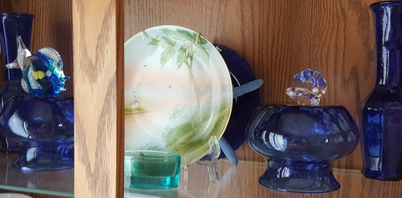 "Glass Fish and Crystal Oyster in China Cabinet ""Ocean in the Middle of Iowa"" frugalfish.org"