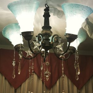 Chandelier with valance behind it